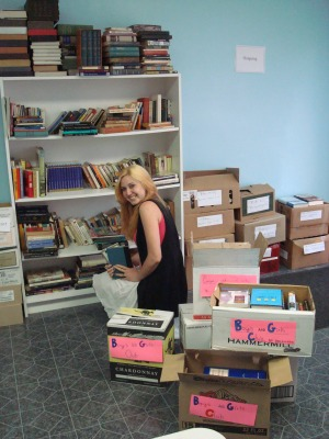 Boys and Girls Club intern Ashley McNeill selects hundreds of books which will enhance the teen center, including SAT prep, reference materials and lots of books for pleasure.