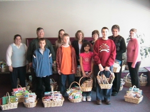 Beverly (center), her staff and students at Back to Basics Learning Dynamics deliver baskets during National I Love to Read Month.