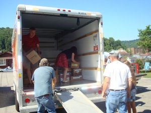 Don (in red) unloads the U-Haul van during a trip to Weston, West Virgina. SWW volunteers donated over 5,000 books to schools, programs and the local library.