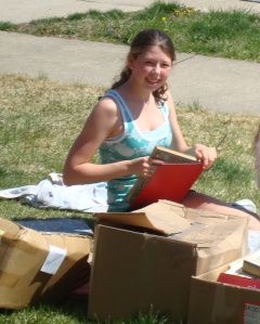 """Naked Book"" Recycling Program, spring 2009. Elizabeth takes advantage of the fine weather!"