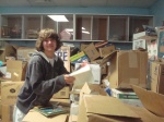 Matt McNeill searches for children's books for the PAL Center of Philadelphia.