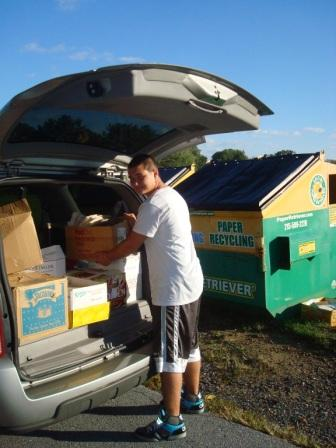 Success Won't Wait volunteer Matt McNeill unloads a van-load of paper to be donated to Brandywine Springs School.