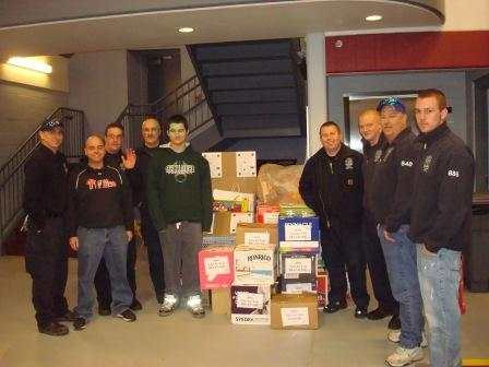 Toys for Tots receives 750 books at the Claymont Fire Station. Pictured is organizer Matt Mcneill with members of the fire station!