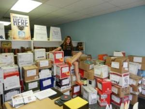 Success Won't Wait volunteer Christine McNeill and just some of the 155 boxes destined for the schoolchildren of New Orleans!