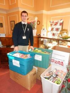 Literacy organization Success Won't Wait donates over 500 new children's books to Toys for Tots program. Volunteer and organizer Matt McNeill pictured.
