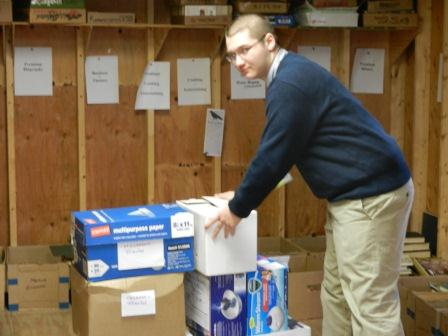 "Success Won't Wait volunteer Matt McNeill loads up the Friends of the Hockessin Library ""shack"" with book donations destined for the group's annual Used Book Sale."