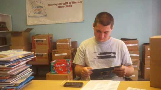 "Over the summer, Matt McNeill labeled books destined for the Back to Basics' ""Reading is Basic"" program. Matt is a 10-year veteran volunteer for Success Won't Wait and a junior at Archmere Academy."