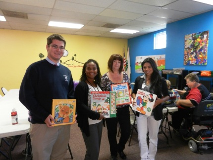 Success Won't Wait volunteer Matt McNeill (far left) and committee members for the Claymont Community Baby Shower with some of the 150+ books donated by Success Won't Wait for attendees.