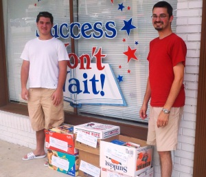 Left to right: Matt McNeill of Success Won't Wait and Shaun Giles for The Central School, pictured with the most recent donation of 250 more pre-teen and teen books for the school.