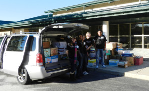 Representatives from hosting team MOE 365 help load the vans filled with donations in 2012. Last year's total topped 4,000 lbs. of books!
