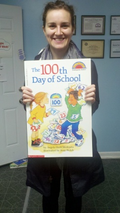 Showing off just one of the many books donated is Camden HeadStart representative Diana Husanu.