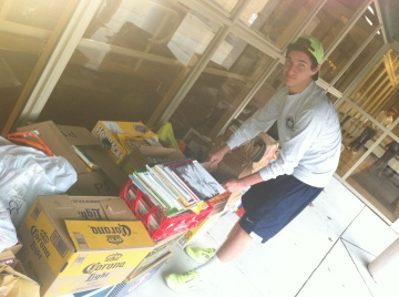 Long-time volunteer Vincenzo Carrieri-Russo helps loads thousands of pounds of donated books at the event.