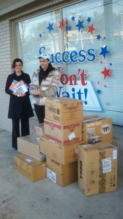 L to R: Julie McDonald of the Delaware Stars program and Vincenza Carrieri-Russo of Success Won't Wait with some of the 800+ children's books ready to be distributed to child care facilities throughout New Caste County, Delaware.