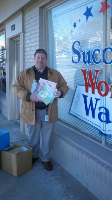 Brian Moore of the Red Clay Consolidated School District with just a few of the 150+ children's books destined for Red Clay's Dr. Seuss's Birthday Celebration!