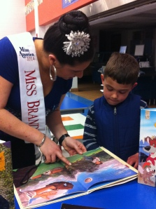 Margerita Carrieri-Russo has been a volunteer for Success Won't Wait since 2002. Pictured here at the Forest Oak Elementary School Literacy Luau with faculty and one of the lucky students who received over 100 children's books from Success Won't Wait at the event.