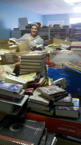 Sorting books is hard work and hardly glamourous, but dedicated volunteers like Margherita Carrieri-Russo keep Success Won't Wait projects going!