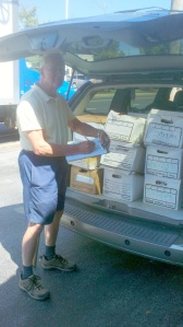 Larry Thurrell of the Friends of the Hockessin Library loads the van with over 750 books destined for the annual Used Book Sale!