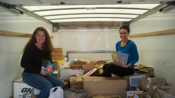 Co-founders Susan Conforte McNeill and Vincenza Carrieri-Russo at the annual Duel on the Delaware Book Drive, 2014.