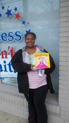 Pictured is Shamiya Thompson of Nemours duPont Pediatrics with just a few of the more than 250 children's books donated to the program by Success Won't Wait.