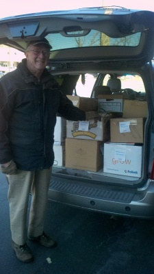 Larry Thurrell of the Friends of the Hockessin Library with just a few of the 500+ books donated by Success Won't Wait.