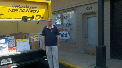 Volunteer Donald McNeill loads the truck with books destined for Camden, NJ>