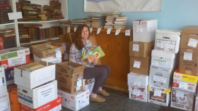 Success Won't Wait volunteer Christine McNeill with just a few of the books which were donated to Camden, NJ schools.