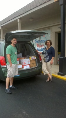 Friends of the Wilmington Library Michael DiLeonardi load the van with 1,000 books for the groups semi-annual Used Book Sale!