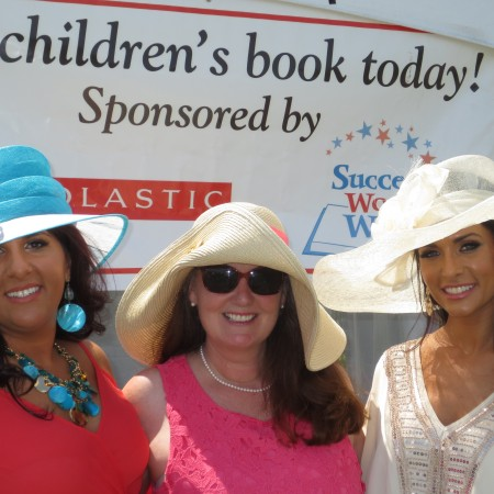 Margherita Carrieri-Russo and Success Won't Wait co-founders Susan Conforte McNeill and Vincenza Carrieri-Russo man the book giveaway tent at 2015 Point-to-Point.