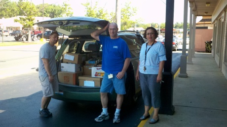 Friends of the Wilmington Library volunteers Michael Dileonardi, David Yeager, and Neda Green with 1,500 books destined for the semi annual Used Book Sale which benefits the library.