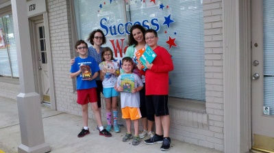Pictured here are Susan Spartz and RCH Founder Jill Fella with hardworking family members Nicolas, Olivia, Sam and Alex.
