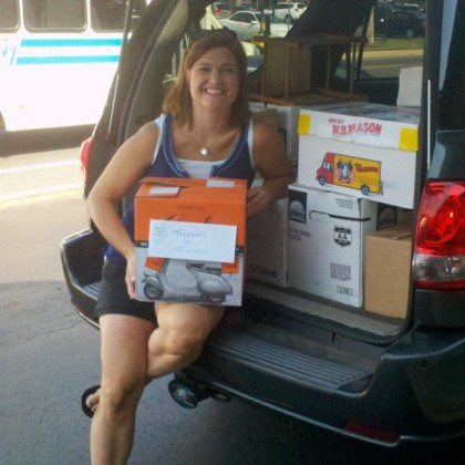 Cristen Zipf of Treasures for Educators with some of the more than 750 books donated by Success Won't Wait this week.