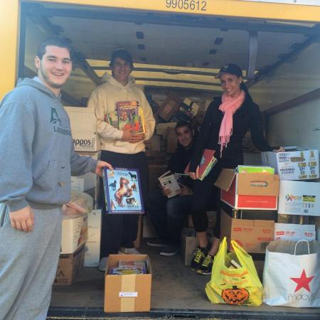 The 2015 event collected over 11,000 lbs. of books! Pictured are Matt McNeill, Vincenzo Carrieri-Russo and Vincenza Carrieri-Russo of Success Won't Wait!