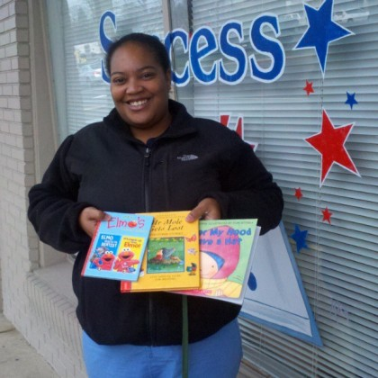 Shamiya Thompson of the Nemours Pediatric Clinic didn't let the cold weather deter her. Her she is, pictured with some of the 300+ children's books that Success Won't Wait donated to nemours' book giveaway program on this blustery January morning!