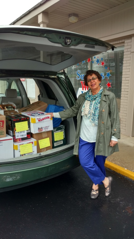 Neda Green, Friends of the Wilmington Library volunteer, here with a van load of books provided by Success Won't Wait!