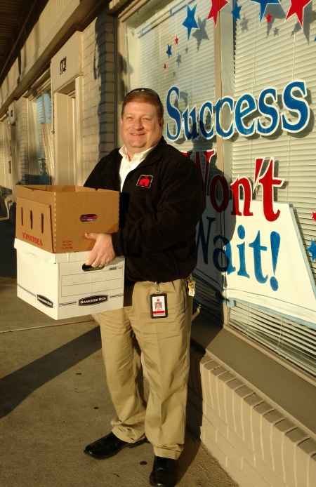 Brian Moore of the Red Clay Consolidated School District with over 100 children's books which will be used as giveaways at school events throughout the district.