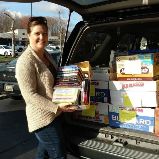 Cristen Zipt of Treasures for Educators with some of the 1,500+ books that Success Won't Wait donated to the program this week!