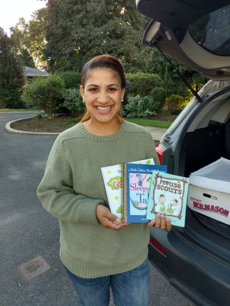 Johanna Vasquez of We Are Their Faces with just a few of the books provided by Success Won't Wait.