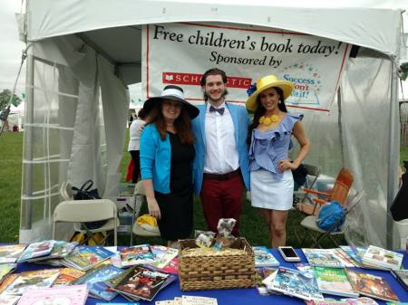 Manning the book giveaway are Success Won't Wait co-founders Susan McNeill (L) and Vincenza Carrieri-Russo (R) with long-time volunteer Matthew McNeill.