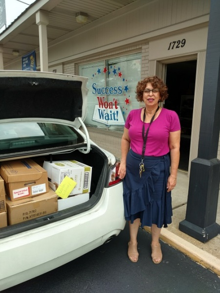 Success Won't Wait supports the Friends of the Wilmington Library with 500+ book donation