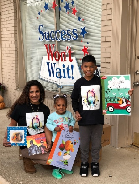 Many thanks to Johanna Vazquez and her family, pictured, who coordinated both book giveaways, and for all of those volunteers at We Are Their Faces, Inc. for encouraging all of us to Make a Change!