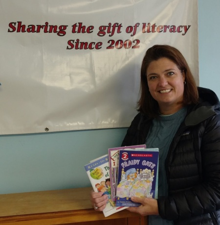 Cristen Zipf, founder of Treasures for Educators with just a few of the books recently donated by Success Won't Wait.